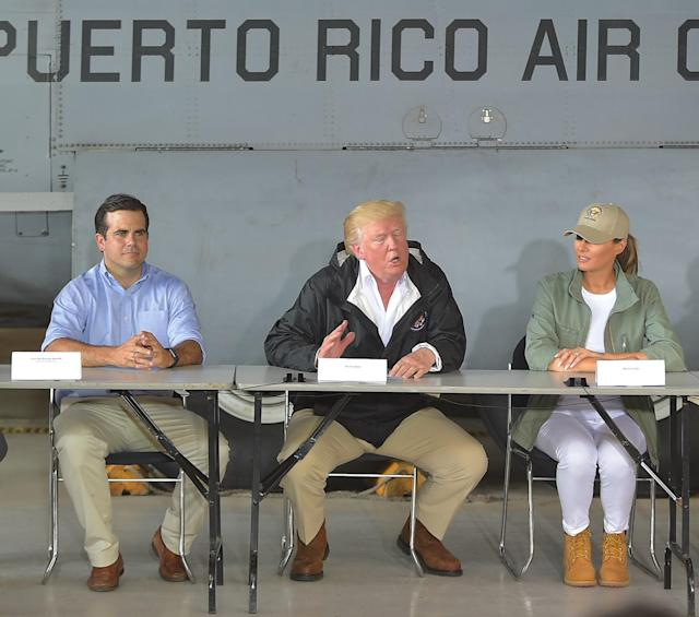President Donald Trump, first lady Melania Trump and Puerto Rico Gov. Ricardo Rosselloat a press briefing in Puerto Rico on Oct. 3.