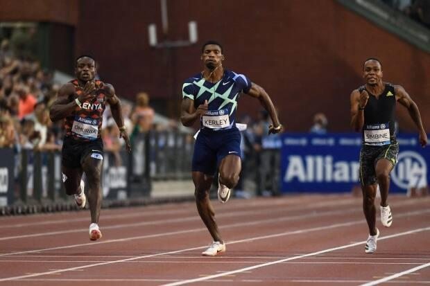 American Fred Kerley, centre, finished in first place with a time of 9.94 seconds in the men's 100-metre event at The Diamond League AG Memorial Van Damme athletics meeting in Brussels, Belgium on Friday. (John Tys/AFP via Getty Images - image credit)