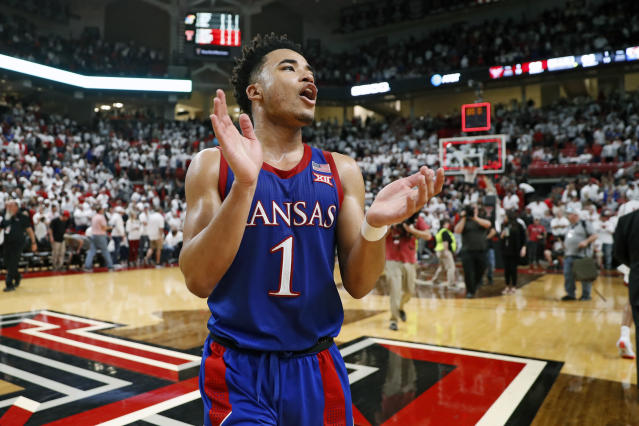 FILE - In this March 7, 2020, file photo, Kansas' Devon Dotson (1) celebrates after an NCAA college basketball game against Texas Tech in Lubbock, Texas. Kansas finished the season No. 1 in The Associated Press college basketball poll, receiving 63 of 65 first-place votes from a national media panel Wednesday, March 18, 2020. (AP Photo/Brad Tollefson, FIle)