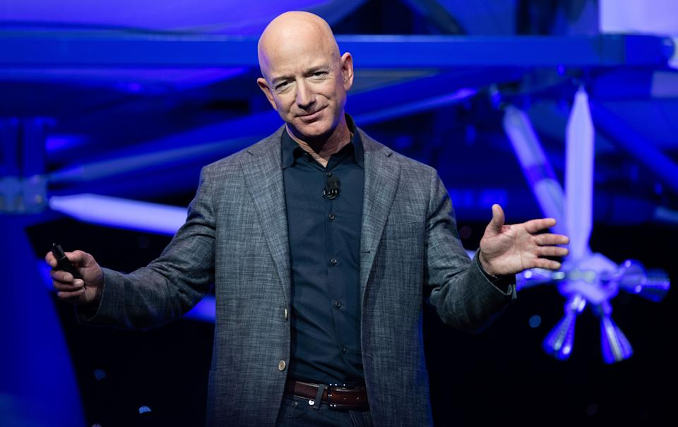 Jeff Bezos announces Blue Moon, a lunar landing vehicle for the Moon, during a Blue Origin event in Washington, DC, May 9, 2019. (Photo by SAUL LOEB / AFP)        (Photo credit should read SAUL LOEB/AFP via Getty Images)