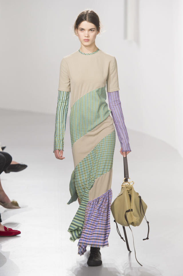 <p><i>Green, beige, and lavender striped maxi dress from the SS18 Loewe collection. (Photo: ImaxTree) </i></p>