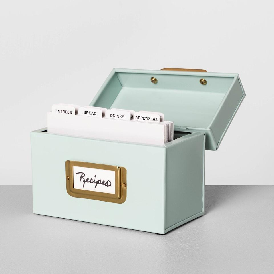 """<p>This mint green and brass recipe box is way too cute to hide in a cabinet—it deserves a spot on the kitchen counter. Fill it with all of your favorite handwritten family recipes. </p> <p><strong>To buy: </strong>$15, <a href=""""http://goto.target.com/c/249354/81938/2092?subId1=RS%2CJoannaandChipGaines%2527sTargetLineIsNearlyDoublingInSize%25E2%2580%2594Our5NewFavorites%2Ckholdefehr1271%2CDEC%2CIMA%2C695189%2C202003%2CI&u=https%3A%2F%2Fwww.target.com%2Fp%2Frecipe-card-holder-hearth-38-hand-8482-with-magnolia%2F-%2FA-76844855"""" target=""""_blank"""">target.com</a>. </p>"""
