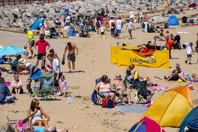 People enjoying the weather on a beach