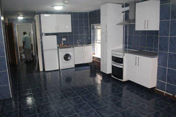 The kitchen area of the tiled flat.