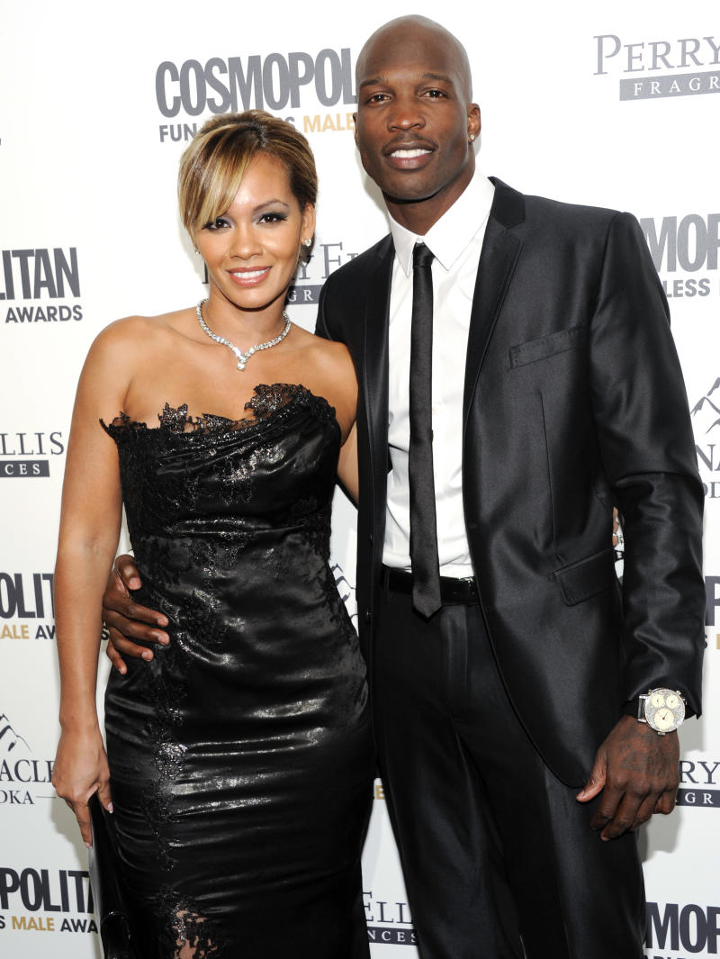 """FILE - In this March 7, 2012 file photo, NFL Football player Chad Ochocinco, right, poses with his fiancee """"Basketball Wives"""" star Evelyn Lozada at the Cosmopolitan Magazine's 'Fun Fearless Males of 2011' event in New York. VH1 said Monday, March 12,  that its eight-part series """"Ev and Ocho"""" chronicling their sports-related celebrity wedding will air in September.  Lozada has been featured in four seasons of """"Basketball Wives,"""" beginning with the end of her engagement to basketball player Antoine Walker. Ochocinco is a wide receiver for the New England Patriots. (AP Photo/Evan Agostini, file)"""