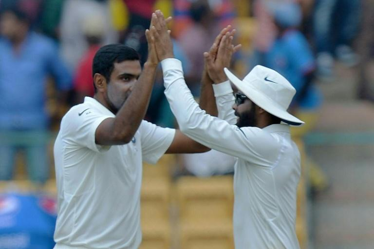 Indian spinner Ashwin Ravichandran Ashwin (left) celebrates the dismissal of Australia batsman Shaun Marsh (not in picture) on the fourth day of the second Test in Bangalore, on March 7, 2017