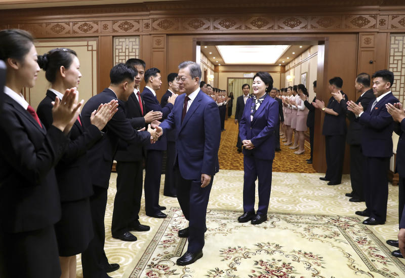 South Korean President Moon Jae-in shakes hands with a staff member of Paekhwawon State Guesthouse as his wife Kim Jung-sook looks on before leaving for the Mount Paektu, in Pyongyang, North Korea, Thursday, Sept. 20, 2018. (Pyongyang Press Corps Pool via AP)