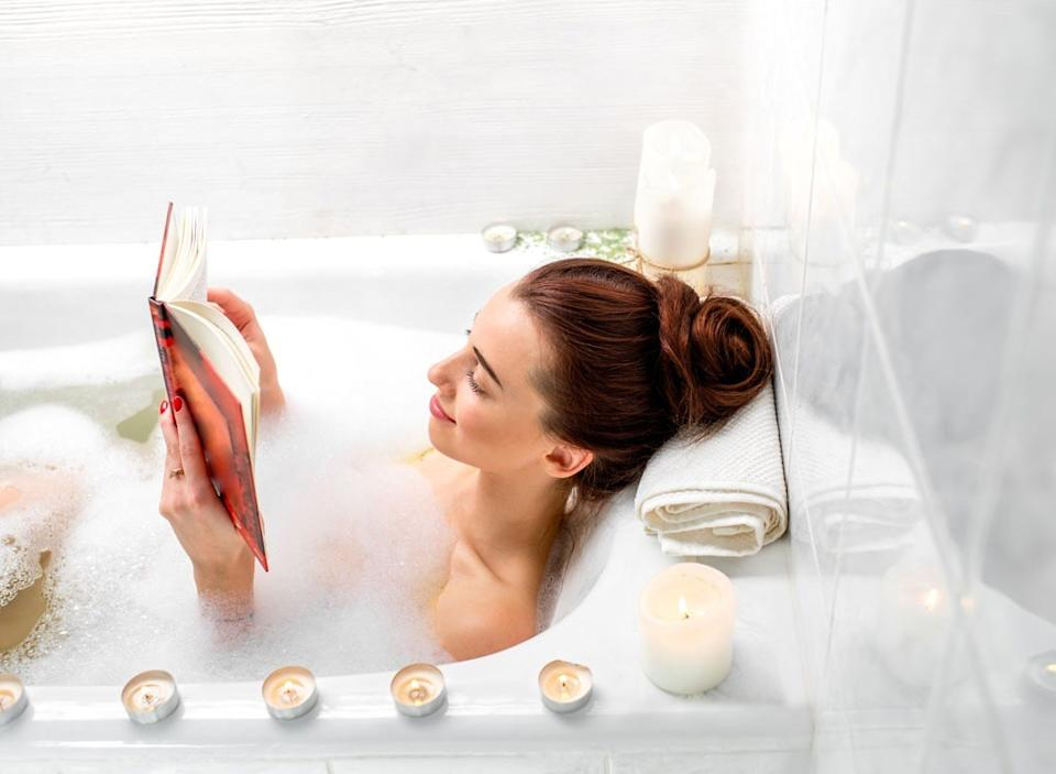 Woman reading in a bath