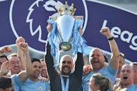Manchester City manager Pep Guardiola holds up the Premier League trophy (AFP/Glyn KIRK)