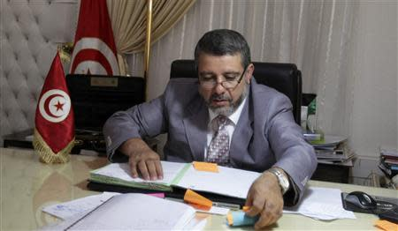 Religious Affairs Minister Khadmi works in his office in Tunis