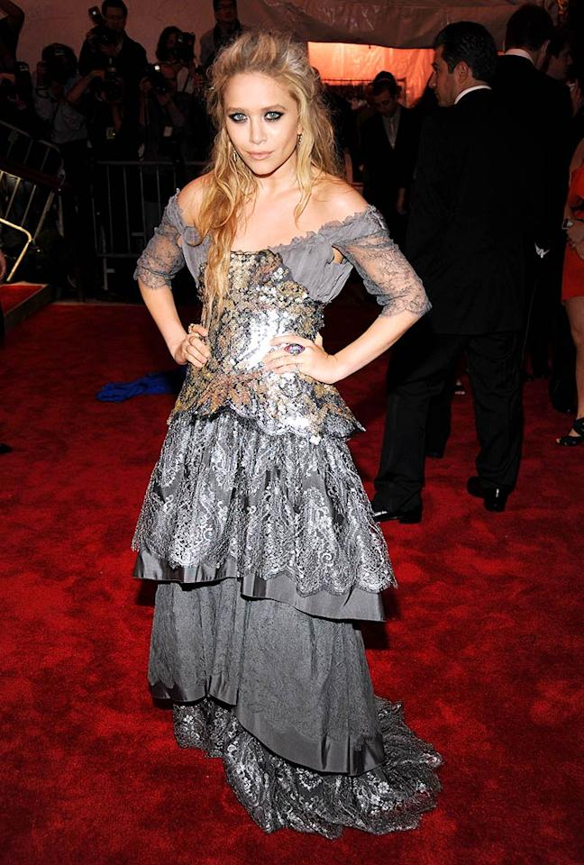"Mary-Kate Olsen delivered some drama in dark eyes, tousled tresses, and a luscious Christian Lacroix couture gown. Kevin Mazur/<a href=""http://www.wireimage.com"" target=""new"">WireImage.com</a> - May 4, 2009"