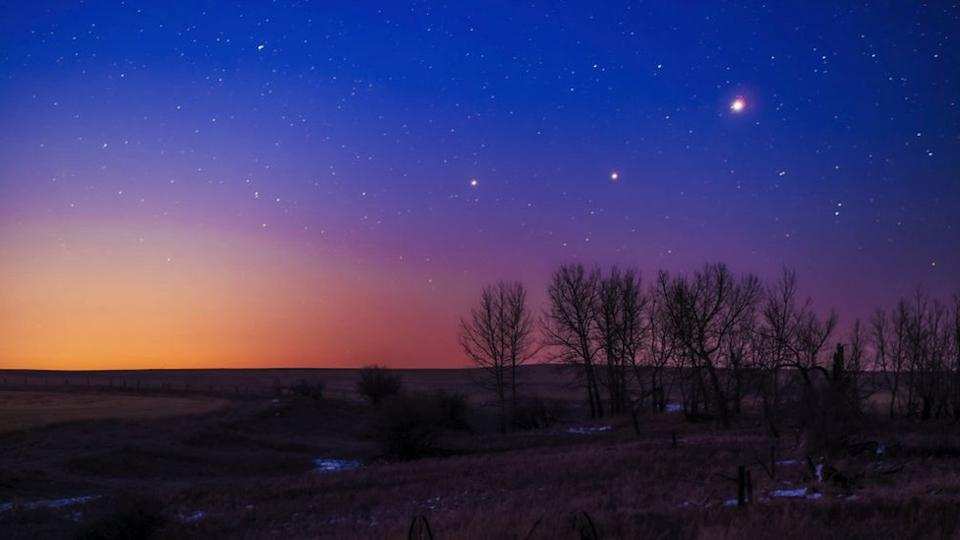 The trio of (L to R) Saturn, Mars and Jupiter in conjunction in the dawn twilight, taken from home in Alberta on March 26, 2020. This is a stack of 10 exposures.