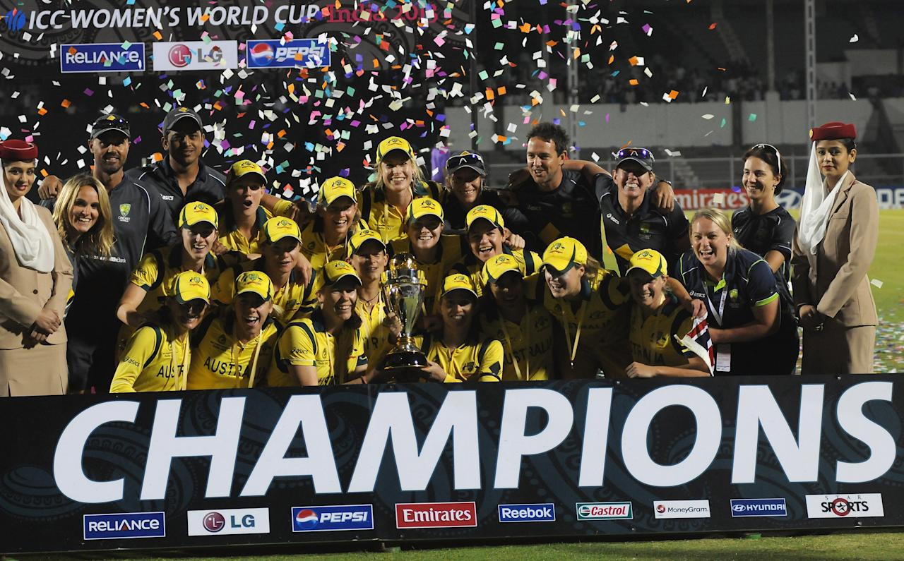 MUMBAI, INDIA - FEBRUARY 17:  Australian team celebrate with the Womens World Cup Trophy after the final between Australia and West Indies, at the CCI (Cricket Club of India) stadium on February 17, 2013 in Mumbai, India.  (Photo by Pal Pillai/Getty Images)