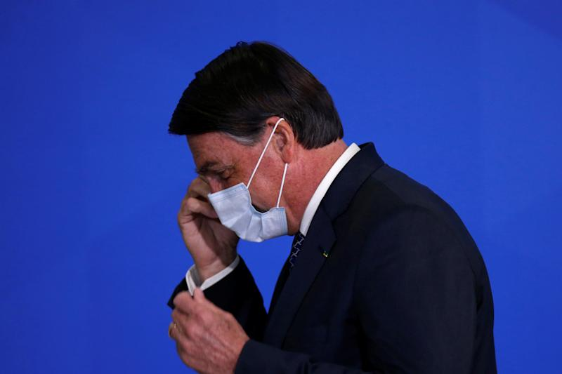 Brazil's President Jair Bolsonaro reacts during a ceremony to launch a program to expand access to credit at the Planalto Palace in Brasilia, Brazil, August 19, 2020. REUTERS/Adriano Machado