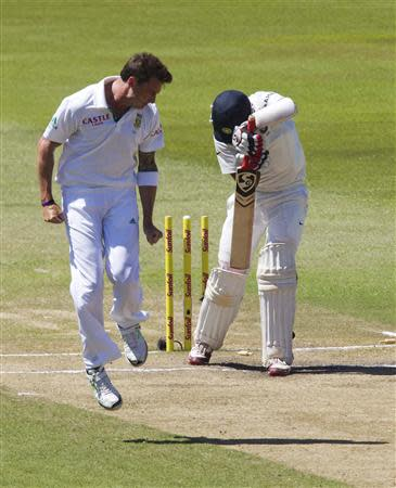 South Africa's Dale Steyn (L) celebrates bowling India's Cheteshwar Pujara (R) during the fifth day of the second test cricket match in Durban, December 30, 2013. REUTERS/Rogan Ward