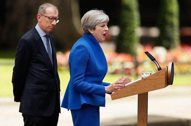 <p>British Prime Minister Theresa May speaks watched by her husband Philip in 10 Downing street, London, as she addresses the press Friday, June 9, 2017 following an audience with Britain's Queen Elizabeth II at Buckingham Palace where she asked to form a government. (Photo: Tim Ireland/AP) </p>