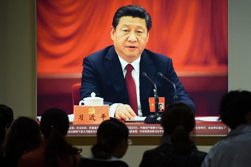 "In addition to general secretary, Xi also has the traditional jobs of president and chairman of the central military commission, but has added a slew of other titles, including ""core"" leader, earning him the nickname ""Chairman of everything"" (AFP Photo/WANG ZHAO)"