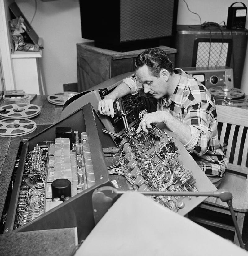 FILE - In this Dec. 20, 1963 file photo, Les Paul repairs one of the many control boards in the control room at his Oakland, N.J., home. Les Paul was a renown musician also known for his innovations on the solid body electric guitar and multitrack recording. The man who helped pave the way for rock 'n' roll is finally getting a permanent exhibit on June 9, 2013 at the Waukesha County Museum in his Wisconsin hometown. (AP Photo/Dan Grossi, file)