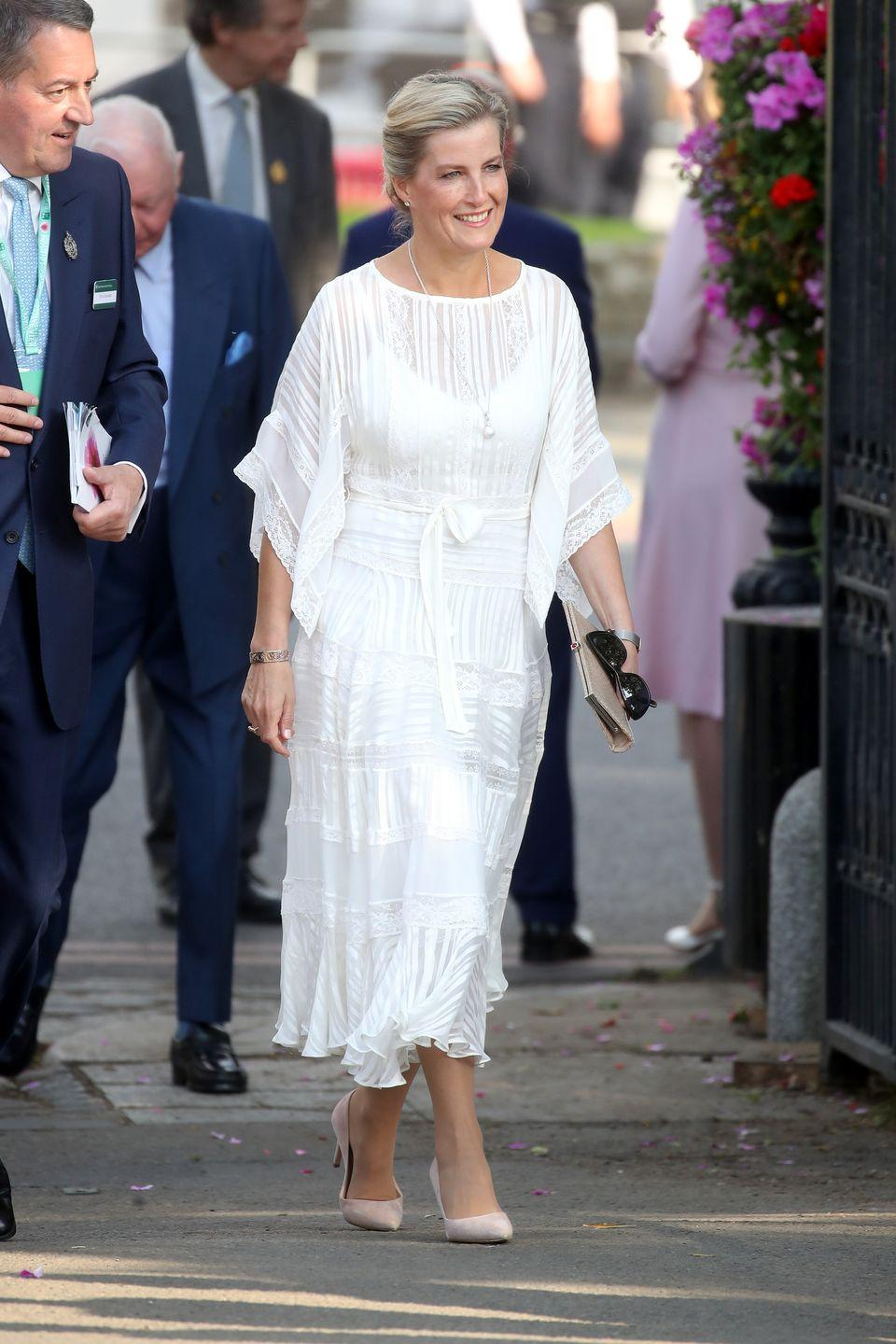 """<p>Sophie looked ethereal in a flowing white dress at <a href=""""https://www.townandcountrymag.com/society/tradition/g20777500/royal-family-chelsea-flower-show-2018-photos/"""" rel=""""nofollow noopener"""" target=""""_blank"""" data-ylk=""""slk:this year's Chelsea Flower Show"""" class=""""link rapid-noclick-resp"""">this year's Chelsea Flower Show</a>.</p>"""
