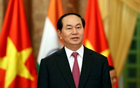 Vietnam's President Quang waits for the arrival of India's PM Modi at the Presidential Palace in Hanoi, Vietnam
