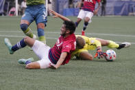 FC Dallas forward Ricardo Pepi, left, lands after jumping over Seattle Sounders goalkeeper Stefan Cleveland during the first half of an MLS soccer match Wednesday, Aug. 4, 2021, in Seattle. (AP Photo/Ted S. Warren)