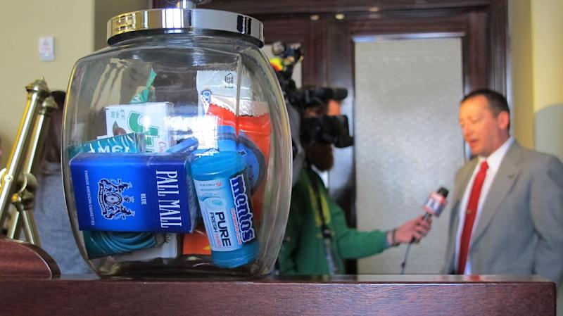 Rep. Paul Ray, R-Clearfield, gives an interview in the background while a candy jar filled with cigarettes and candy sit on a podium following a news conference Wednesday, Rep. March 6, 20013, at the Utah State Capitol, in Salt Lake City. Ray wants to make electronic cigarettes and dissolvable tobacco products taxable. The alternative cigarettes are battery-powered devices that heat a liquid nicotine solution and create vapor that users inhale. Currently, anyone can buy them because they're not classified as tobacco products. Ray sponsored the bill, which would also bar anyone under the age of 19 from entering a smoke shop. (AP Photo/Michelle Price)