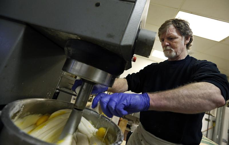 In this March 10, 2014 photo, Masterpiece Cakeshop owner Jack Phillips cracks eggs into a cake batter mixer inside his store, in Lakewood, Colo. Phillips is appealing a recent ruling against him in a legal complaint filed with the Colorado Civil Rights Commission by a gay couple he refused to make a wedding cake for, based on his religious beliefs. (AP Photo/Brennan Linsley)