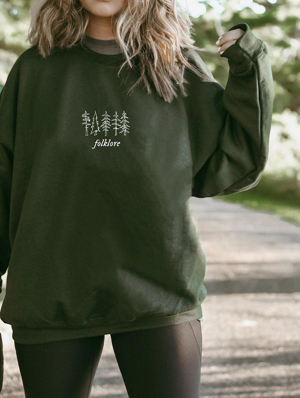 <p>Get them something cozy and cuddle-worthy like this <span><b>Folklore</b> Crew Neck Sweatshirt</span> ($35, and up). It's perfect for the ones who resonate with <b>Folklore</b> and such a fall/winter vibe. It comes in dark grey as well!</p>