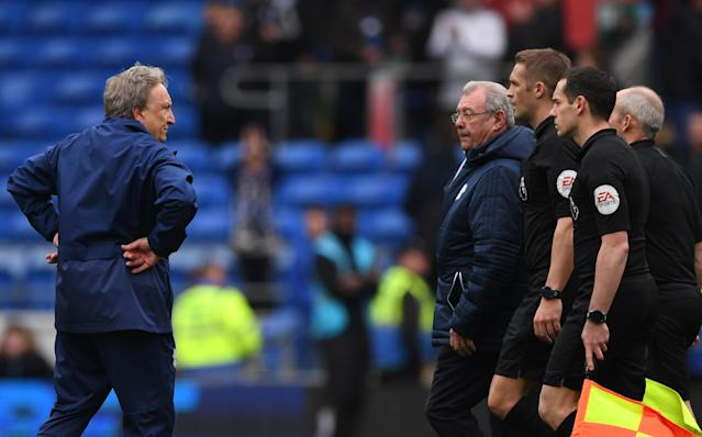 Neil Warnock faces off with the officials from Sunday's game between Cardiff and Chelsea.