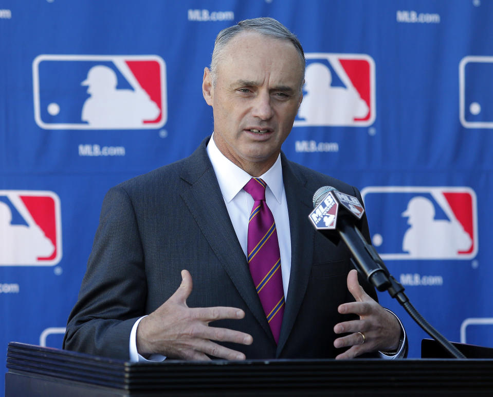 Commissioner-elect Rob Manfred speak with the media during a news conference at the Major League Baseball owners meeting, Thursday, Jan. 15, 2015, in Phoenix. Manfred succeeds Bud Selig when he retires later this month. (AP Photo/Rick Scuteri)