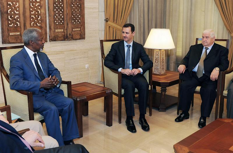 This photo released by the Syrian official news agency SANA, shows United Nations-Arab League special envoy to Syria Kofi Anan, left, meeting with Syrian President Bashar Assad, center, in Damascus, Syria, Monday, July 19, 2012. International envoy Annan raised hopes of a revived peace effort in Syria, saying he has reached a framework with President Bashar Assad and would hold talks with rebel leaders. Syrian Foreign Minister Walid Muallem, sits at right (AP Photo/SANA)