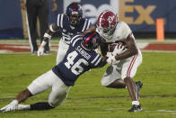 Mississippi linebacker MoMo Sanogo (46) tackles Alabama running back Najee Harris during the first half of an NCAA college football game in Oxford, Miss., Saturday, Oct. 10, 2020. (AP Photo/Rogelio V. Solis)