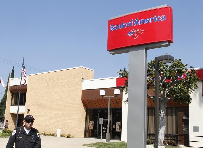 A security guard patrols outside a Bank of America office in Burbank