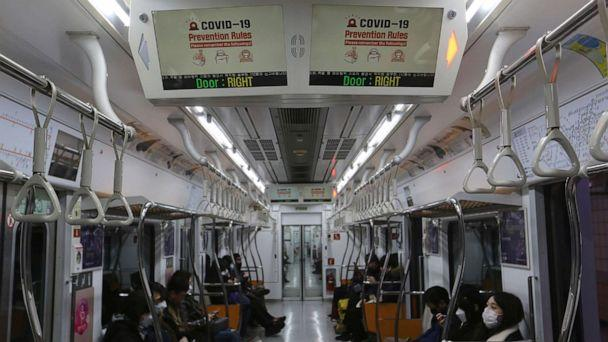 PHOTO: Electric screens about precautions against the illness COVID-19 are seen in a subway train in Seoul, South Korea, Sunday, Feb. 23, 2020. (Ahn Young-joon/AP)