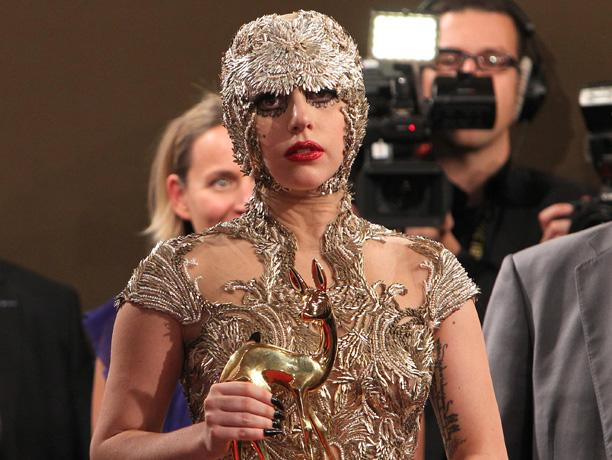USsinger Lady Gaga leaves with her International Pop award during the Bambi awarding ceremony in Wiesbaden, Germany