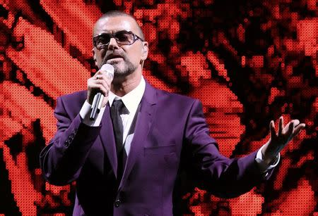 "FILE PHOTO - British singer George Michael performs on stage during his ""Symphonica"" tour concert in Vienna September 4, 2012. REUTERS/Heinz-Peter Bader/File Photo"