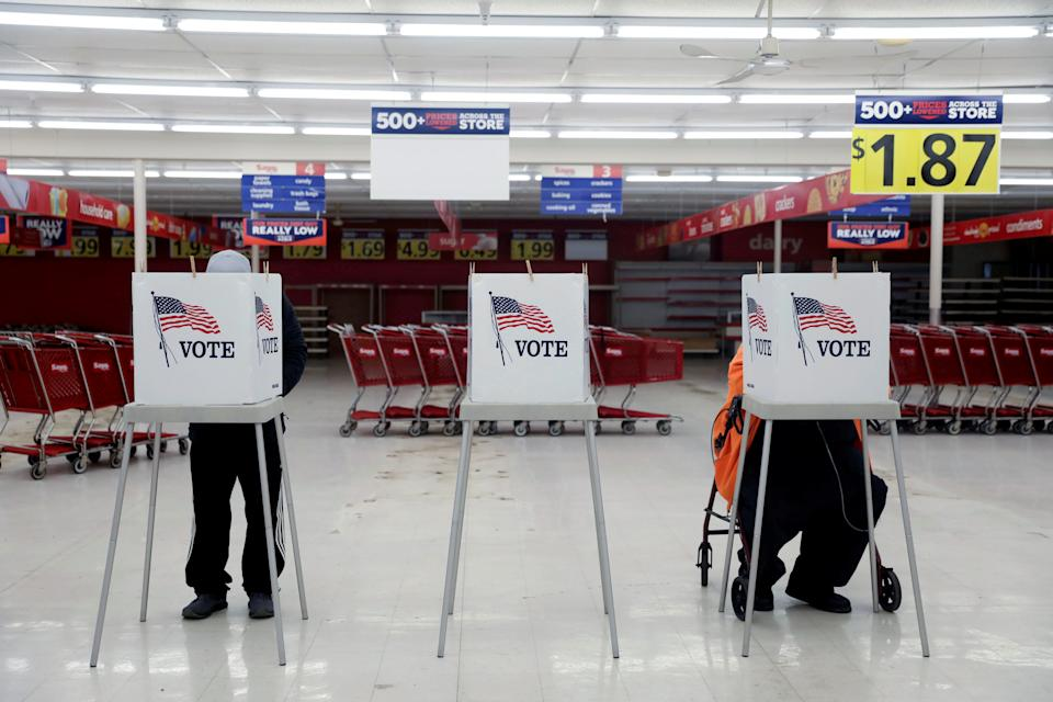 Voters fill out ballots during the primary election in Ottawa, Illinois, U.S., March 17, 2020. The polling station was relocated from a nearby nursing home to a former supermarket due to concerns over the outbreak of coronavirus (COVID-19). REUTERS/Daniel Acker     TPX IMAGES OF THE DAY