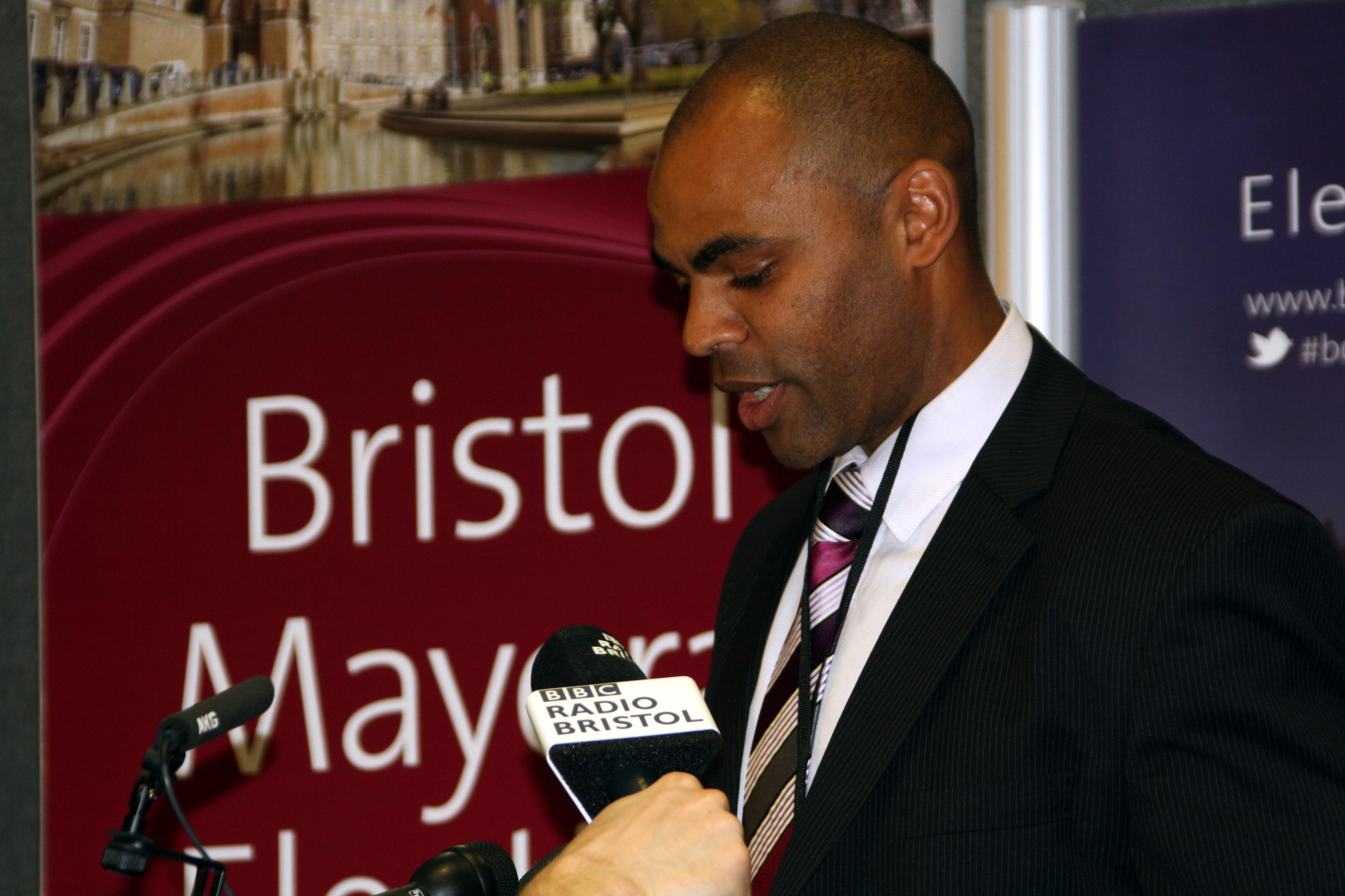 Labour's defeated Bristol Mayor candidate Marvin Rees listens as election winner - Independent George Ferguson - addresses his supporters, after winning the Bristol Mayoral election, at the election count held at the University of the West of England in Bristol.