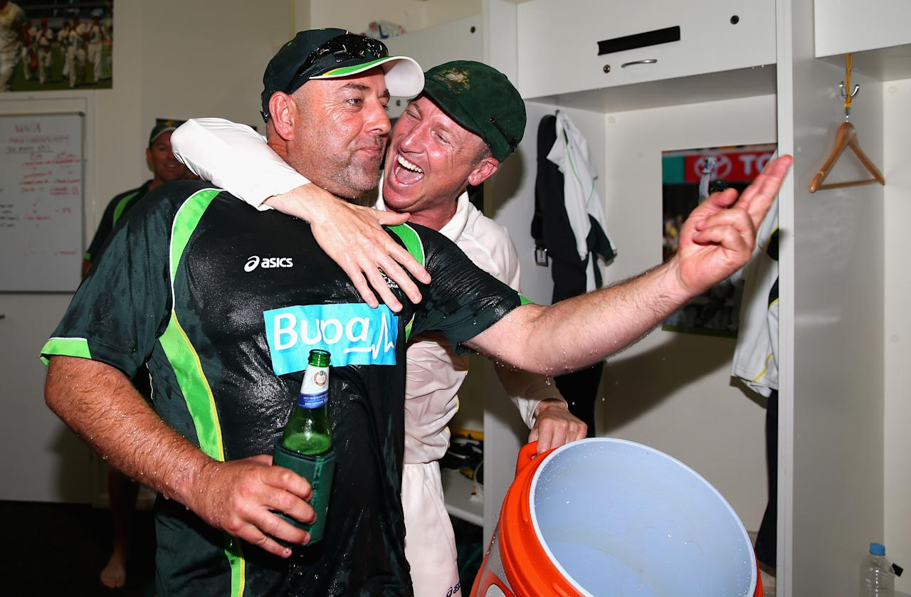 PERTH, AUSTRALIA - DECEMBER 17:  Brad Haddin of Australia celebrates with Darren Lehmann, coach of Australia, during day five of the Third Ashes Test Match between Australia and England at WACA on December 17, 2013 in Perth, Australia.  (Photo by Ryan Pierse/Getty Images)