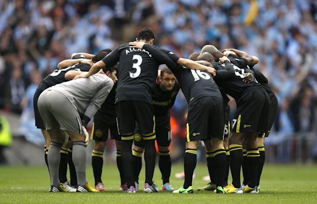 Wigan Athletic players form a huddle prior to kick-off