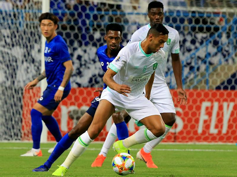 Ahli Saudi's Brazilian midfielder Joseph de Souza (C, front) dribbles the ball during the AFC Champions League play-off football match between Saudi's al-Ahli and al-Hilal at King Saud University Stadium in the Saudi capital Riyadh on August 13, 2019. (Photo by - / AFP) (Photo credit should read -/AFP via Getty Images)