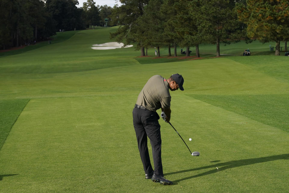 Tiger Woods drives on the eighth tee during the first round of the Masters golf tournament Thursday, Nov. 12, 2020, in Augusta, Ga. (AP Photo/David J. Phillip)