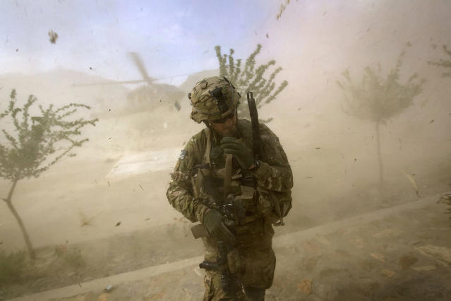 <p>2nd Lt. Andrew Ferrara, 23, of Torrance, Calif., with the U.S. Army's Bravo Company of the 25th Infantry Division, 3rd Brigade Combat Team, 2nd Battalion 27th Infantry Regiment, based in Schofield Barracks, Hawaii, turns from the rotor wash of a landing Blackhawk helicopter during a mission for a key leader engagement at the Shigal district center, Sept. 15, 2011 in Kunar province, Afghanistan. (AP Photo/David Goldman) </p>