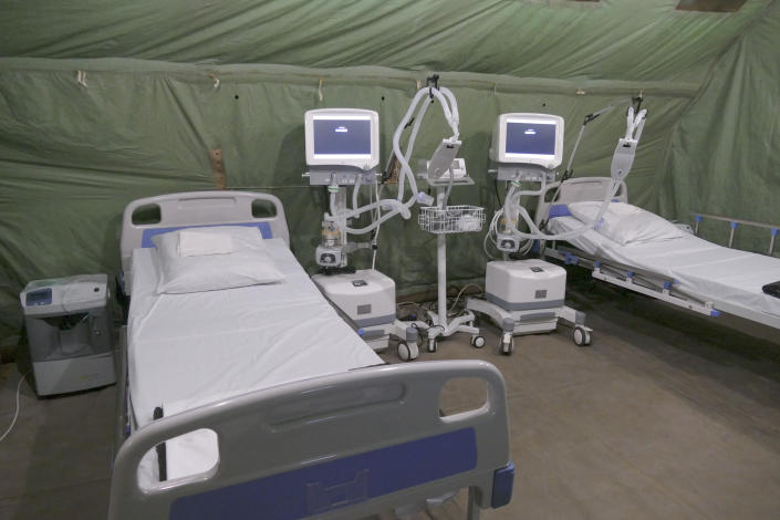 In this photo released by Ukraine's Emergency Situation Ministry on Feb. 20, 2021, a mobile hospital is set up in front of a regional hospital in the Ivano-Frankivsk region, Ukraine. After several delays, Ukraine finally on Tuesday, Feb. 23, 2021, received 500,000 doses of the AstraZeneca vaccine marketed under the name CoviShield, the first shipment of Covid-19 vaccine doses. The country of 40 million is one of the last in the region to begin inoculating its population. (Emergency Situation Ministry via AP)