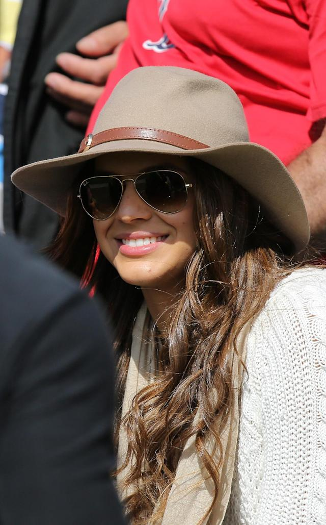 Neymar's girlfriend, the Brazilian actress Bruna Marquezine, sits in the stands along with with fans of the Brazilian national soccer team, during a practice session at the Granja Comary training center in Teresopolis, Brazil, Sunday, June 1, 2014. Brazil will travel this Sunday for the team's warm-up against Panama on Tuesday in preparation for the World Cup soccer tournament that starts on 12 June. (AP Photo/Leo Correa)