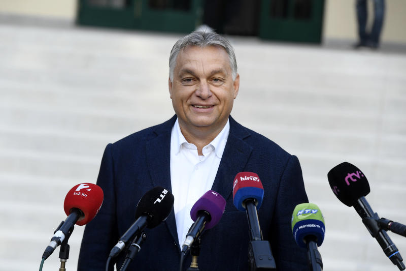 Hungarian Prime Minister Viktor Orban of the governing Fidesz party delivers a statement after he cast his ballot at the nationwide local elections in Budapest, Hungary, Sunday, Oct. 13, 2019. (Szilard Koszticsak/MTI via AP)
