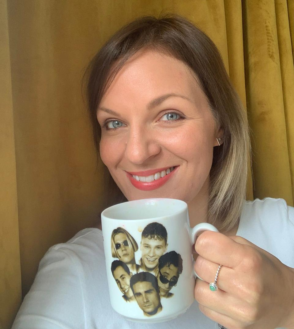 Carly and her favourite mug, which definitely doesn't have tea in it. (Photo: )