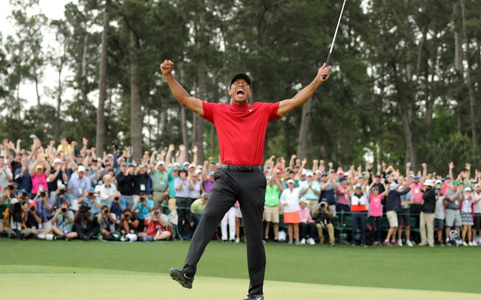 Tiger Woods of the U.S. celebrates on the 18th hole to win the 2019 Masters at Augusta National Golf Club in Augusta, Georgia, U.S. April 14, 2019 - REUTERS/LUCY NICHOLSON