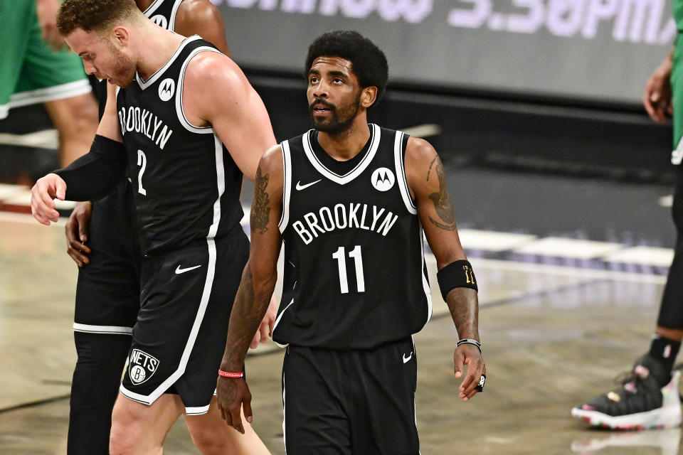 Kyrie Irving #11 of the Brooklyn Nets looks on against the Boston Celtics in Game One of the First Round of the 2021 NBA Playoffs at Barclays Center at Barclays Center on May 22, 2021 in New York City. NOTE TO USER: User expressly acknowledges and agrees that, by downloading and or using this photograph, User is consenting to the terms and conditions of the Getty Images License Agreement.  (Photo by Steven Ryan/Getty Images)
