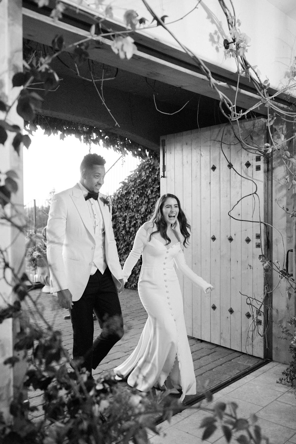 "Walking into our enchanted reception. My inspiration was an uninhabited and untamed garden, overgrown with flowers, branches, and vines. <a href=""https://www.instagram.com/hart_floral/?hl=en"" rel=""nofollow noopener"" target=""_blank"" data-ylk=""slk:Hart Floral"" class=""link rapid-noclick-resp"">Hart Floral</a> and <a href=""https://www.instagram.com/orenco.co/?hl=en"" rel=""nofollow noopener"" target=""_blank"" data-ylk=""slk:Yifat Oren"" class=""link rapid-noclick-resp"">Yifat Oren</a> completely transformed the space and brought my vision to life. As you can see in the photo, it literally made my jaw drop."